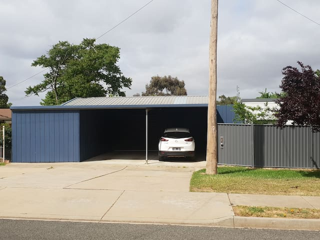 Your parking space to the left and entrance gate to the right of carport.