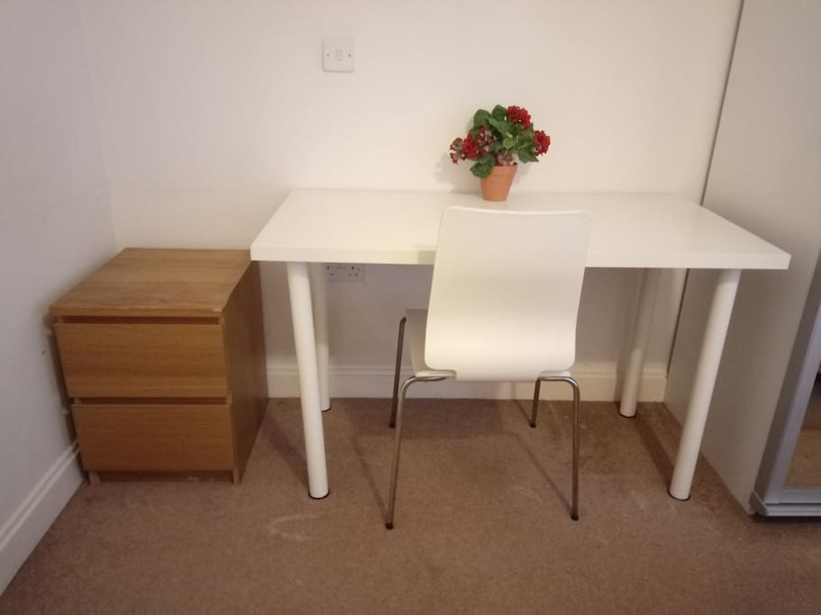 Worktop with chair and bedside table