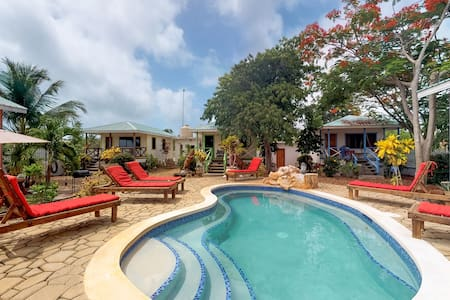 Cabana walking distance from the beach with shared pool, patio area and grill