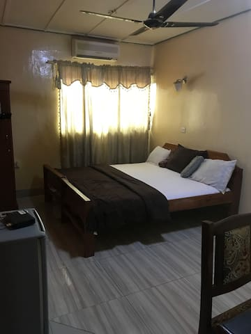 Nice room with double bed sleeps 2  people;. Air condition,  fridge,  bath and shower, desk, fan, TV, private door,  wardrobe with key, private toilet.