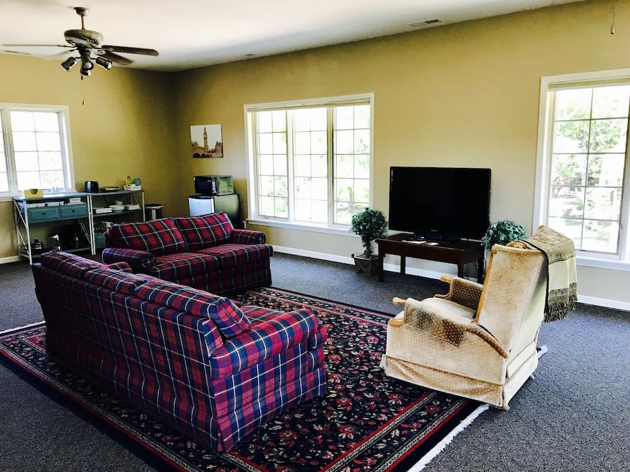 Clean and comfortable furniture and a large flat screen TV with premium channels.