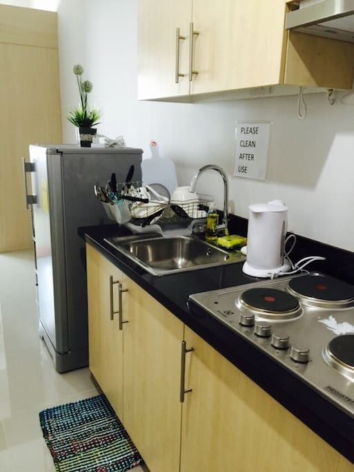 Kitchen, complete with dinnerware, utensils, cutleries, microwave, electric kettle, toaster, rice cooker (free dishwashing detergent and sponge).