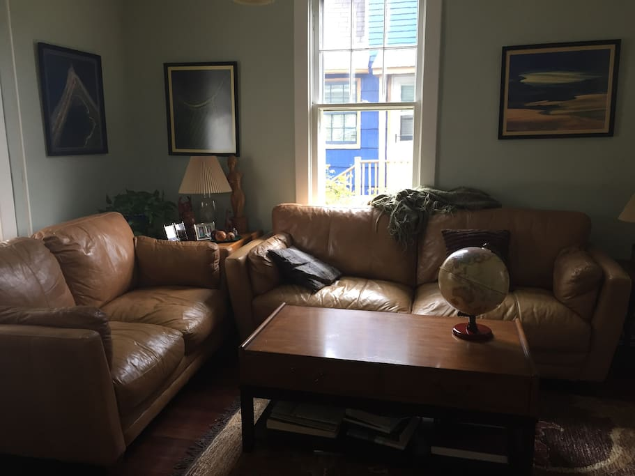 Comfortable leather couches and chairs make up living room