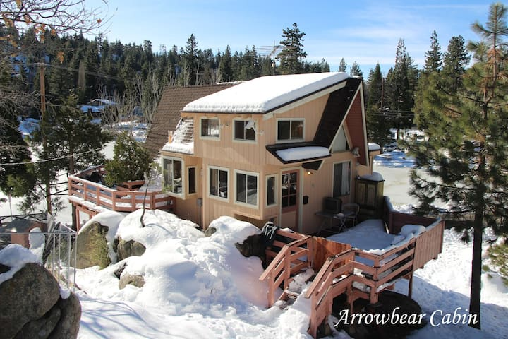 Year Round Beauty and Serenity (Front Deck and Entrance). Short hike up the hill over majestic boulders, gives the real Mountain Cabin experience. Gorgeous views from every window! No Cabins on either side for plenty of privacy. Rap around deck.