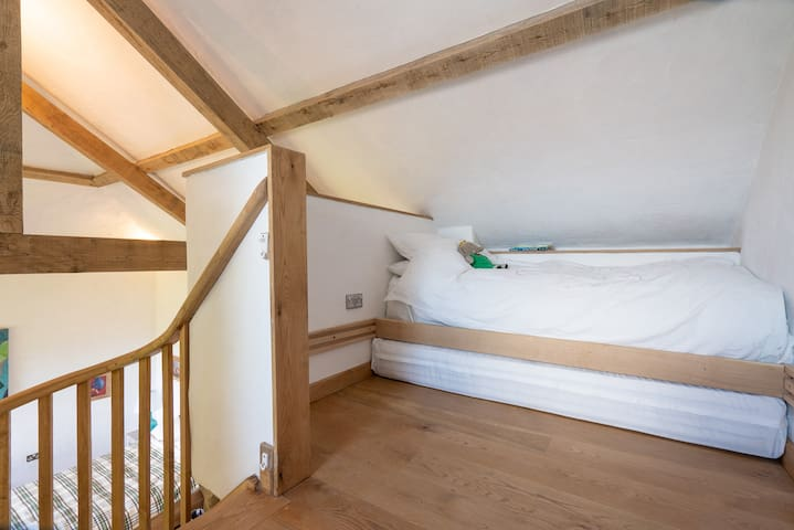 Mezzanine bed. This bed is single, but can pull out to make a double. Most suitable for younger children. Can sleep teenagers and adults, but the space between the bed and the sloped ceiling is narrow.