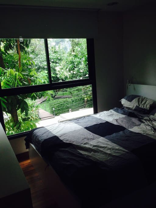 Bedroom with ample storage and peaceful green view on Japanese garden + golf driving range