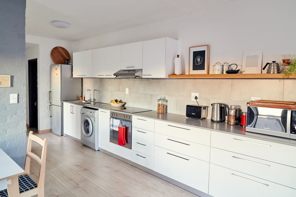 Fully equipped kitchen, glass top electric stove and oven