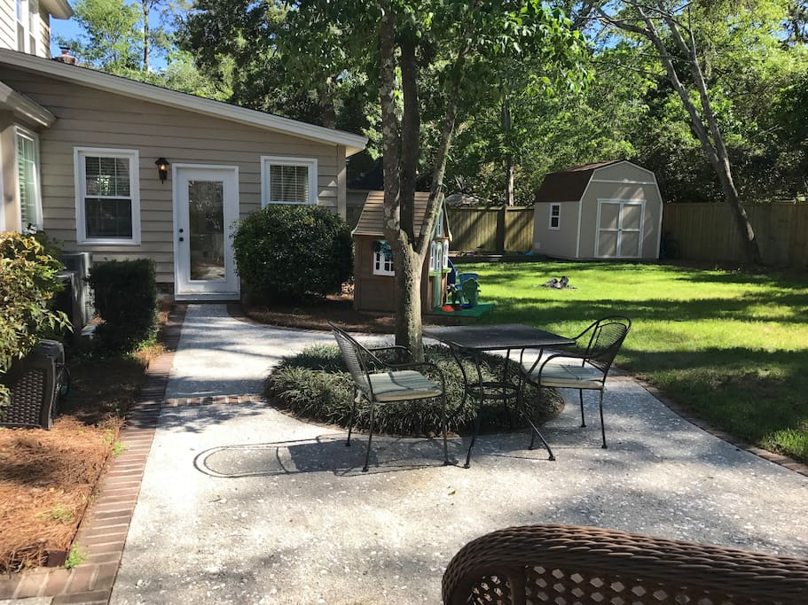 Backyard with oyster shell patio