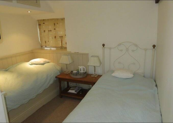 The comfortable guest bedroom , in a small converted barn.