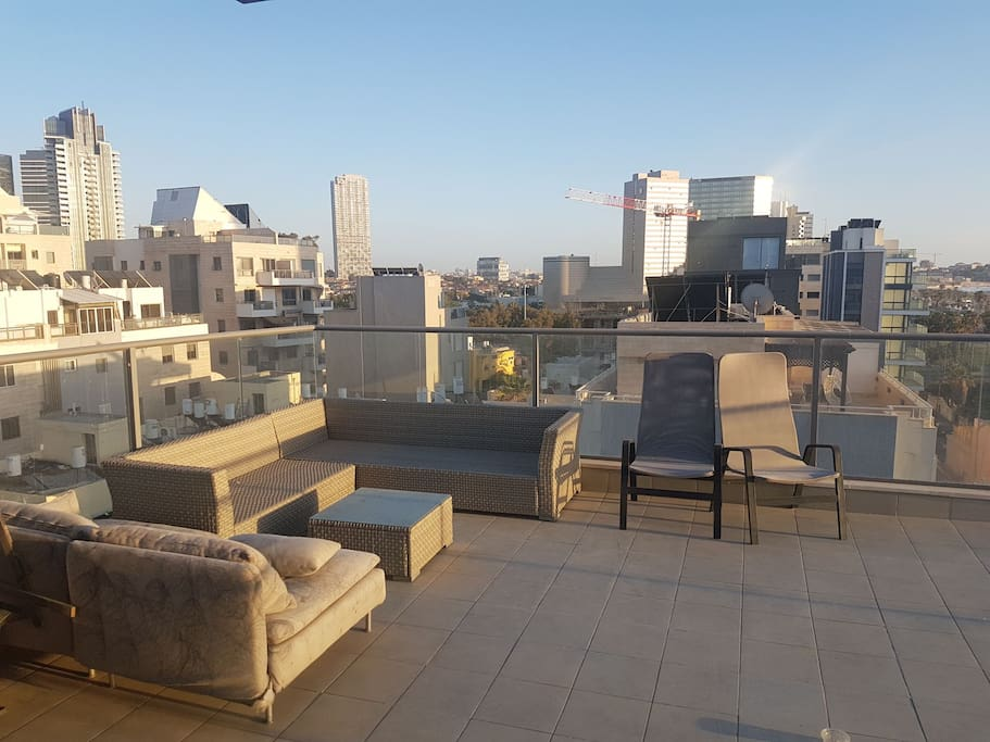 Roof terrace with sofas and bbq