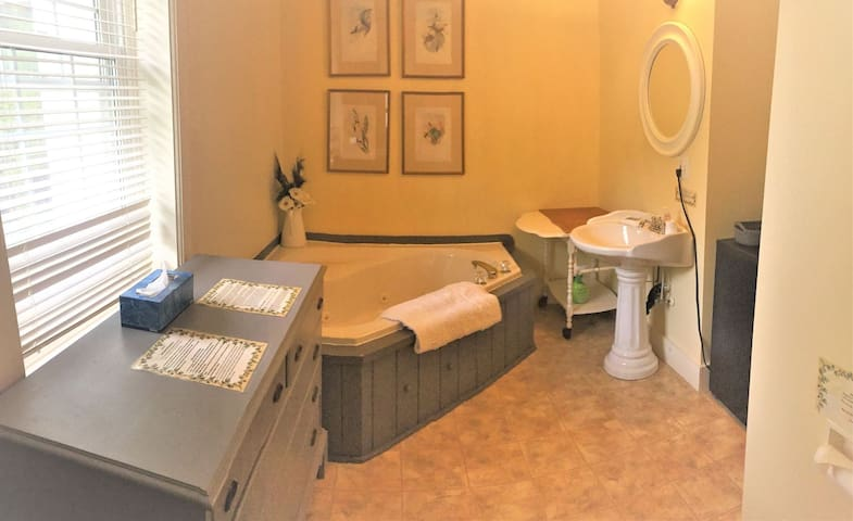 Private en suite bathroom has both a jacuzzi tub and a separate shower.