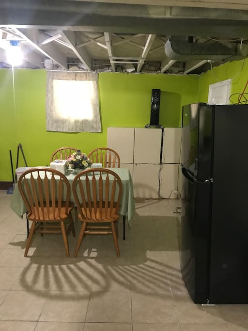 this is dining room with dining table, a refrigerator is all for you to use.