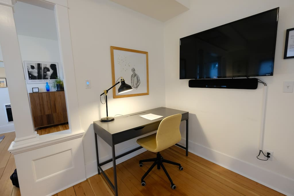 Corner desk space nook has an adjustable office chair with good lumbar support