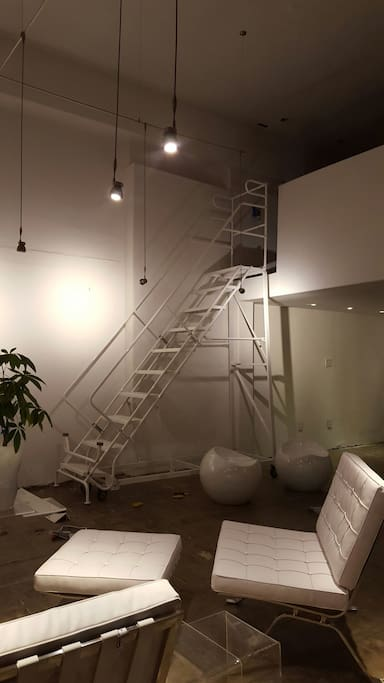 ROLLING INDUSTRIAL LADDER LEADS TO LOFT