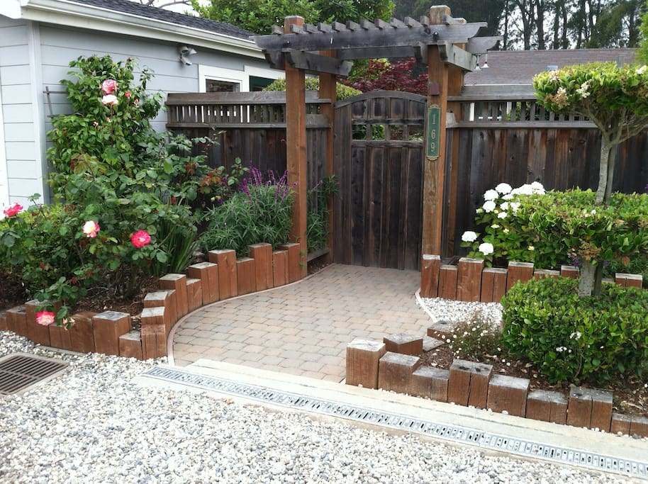 Entry way to private, fenced yard and lovely garden with your own private hot tub