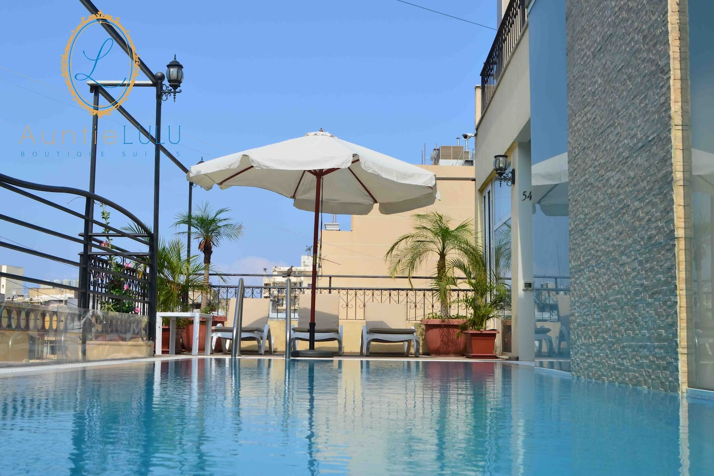 Enjoy a swim and tan at the roof top pool and deck