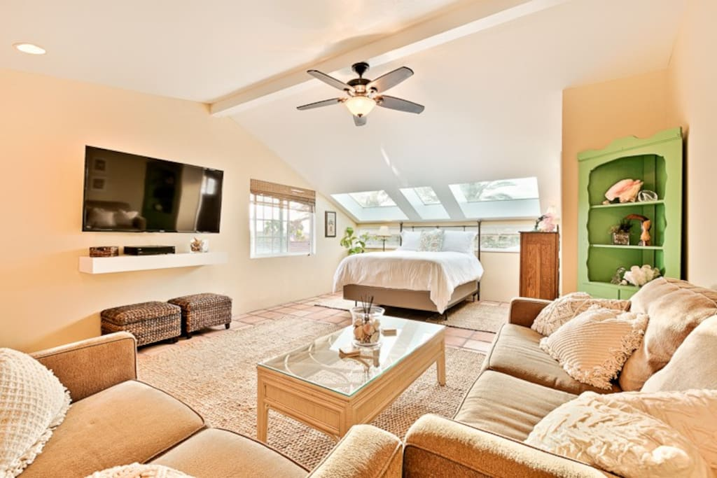 A ceiling fan for your comfort and a queen bed in the alcove.