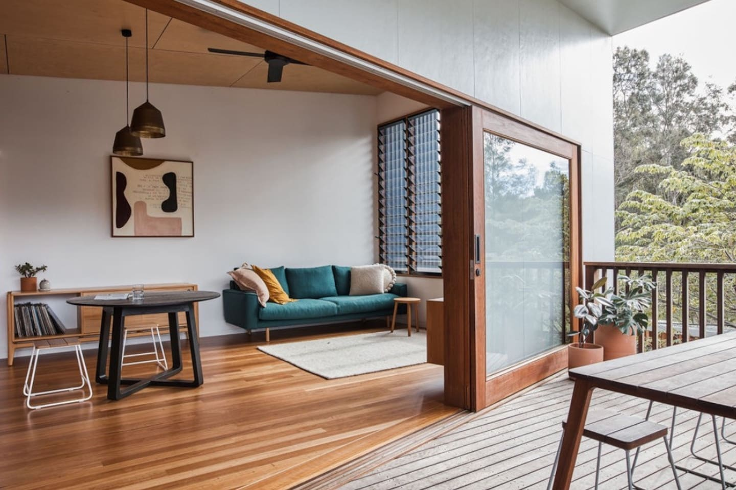 Living area opens up onto the deck to bring the outside in