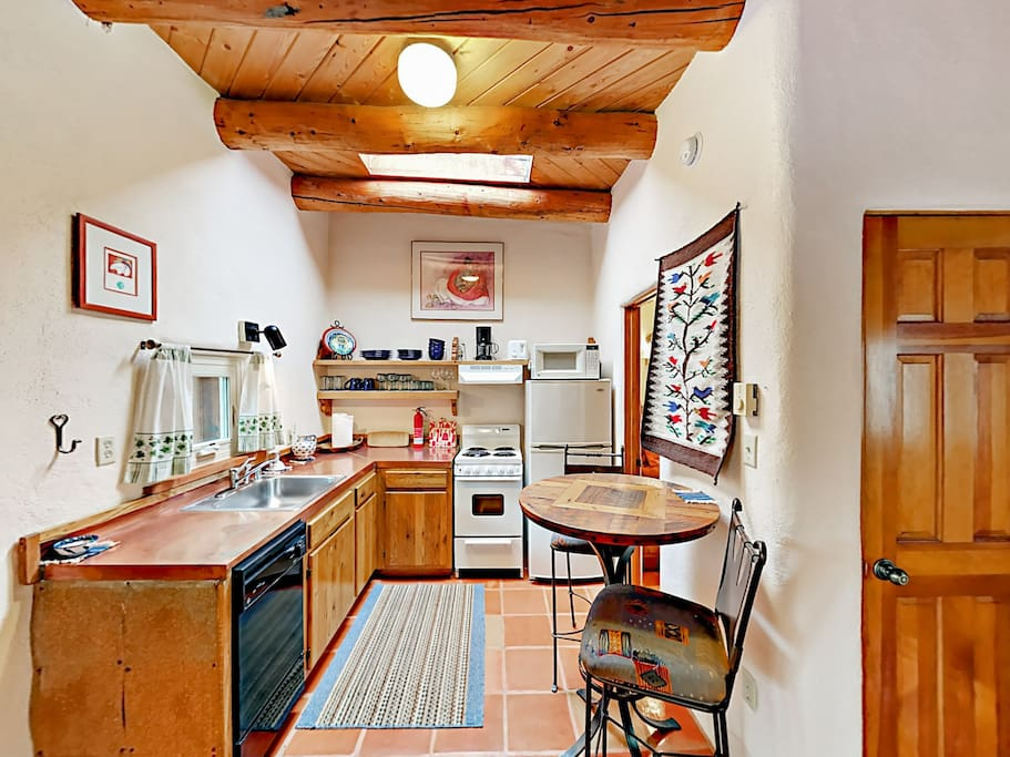Find everything you need in the well-equipped kitchen with a full suite of appliances.