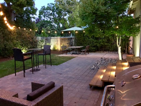 Private backyard with plenty of seating, eating area, and gas grill. There are also outdoor speakers hooked up to the wi-fi network for streaming your favorite music outside straight from your mobile device.