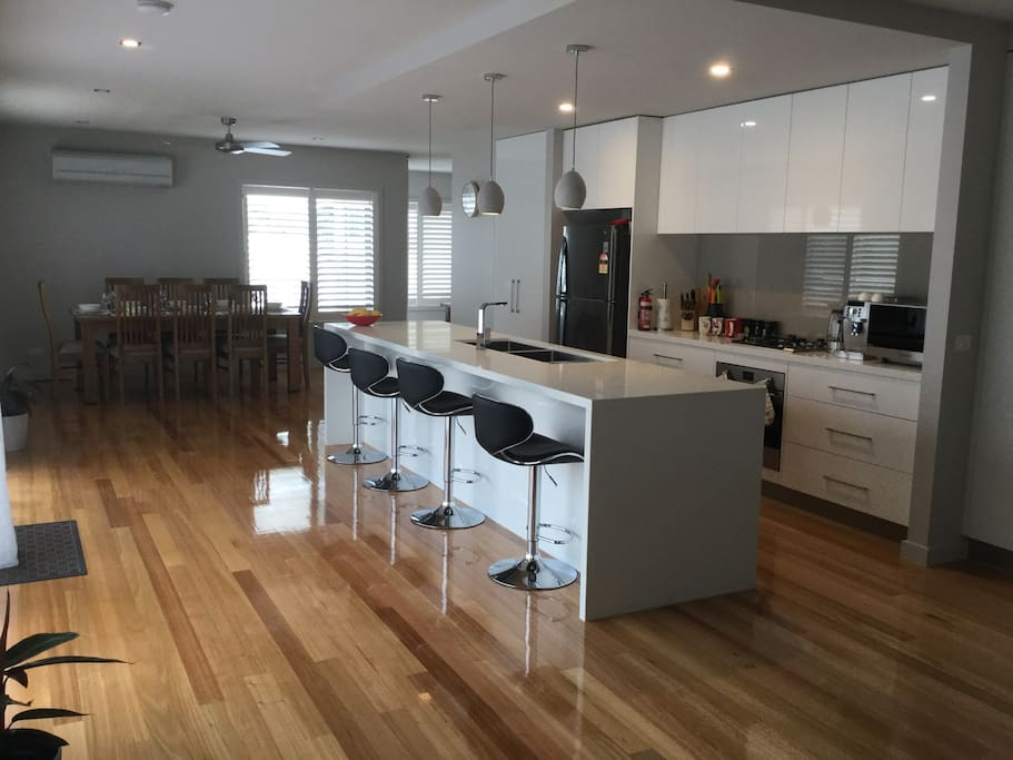 Hostess kitchen with everything you could wish for to entertain with. Large dining area, breakfast bar, & beautiful, easy care polished wooden floors.