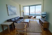 Enjoy this view of NYC from the comfort of your own furnished space.