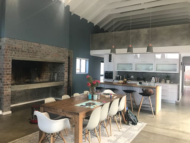 Open plan kitchen and living area with big braai/fireplace