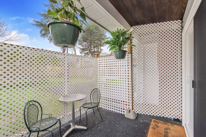 Fresh air No problem Beautiful patio looking to the back yard.