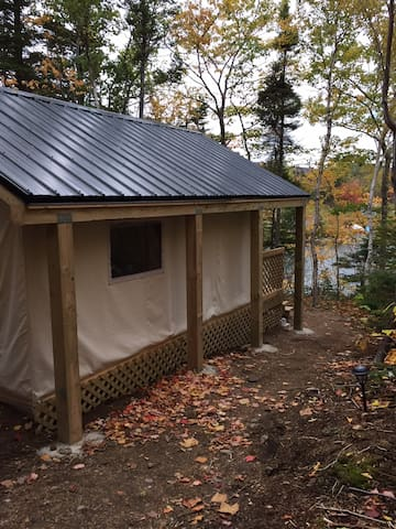 12'x14' covered canvas tent with 4'x12 covered deck