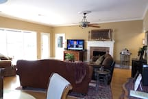 "Our living room with 55"" flat screen for you to enjoy!"