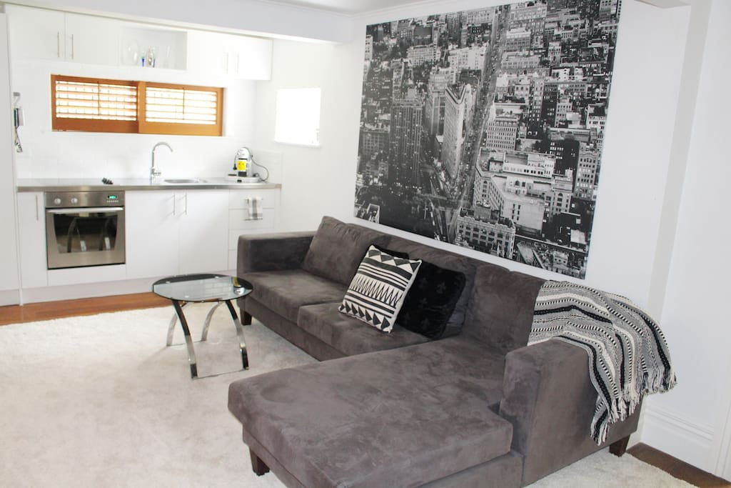 Comfortable sectional sofa, contemporary black and white artwork