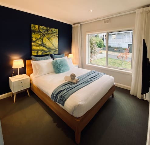 Bedroom 1 with comfortable queen bed and smart tv
