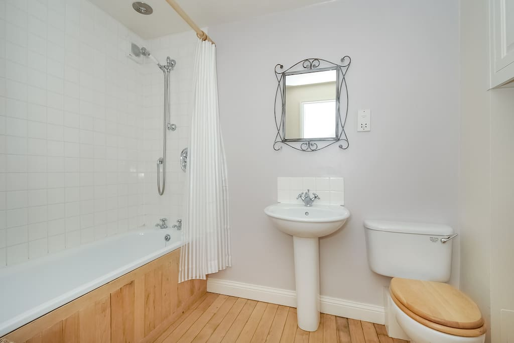 Bathroom with bath, wc and over-bath shower