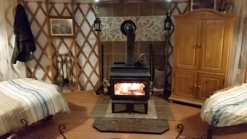 Large Stove, insulated & warm. 2 Closets, Down comforters, wood floors.