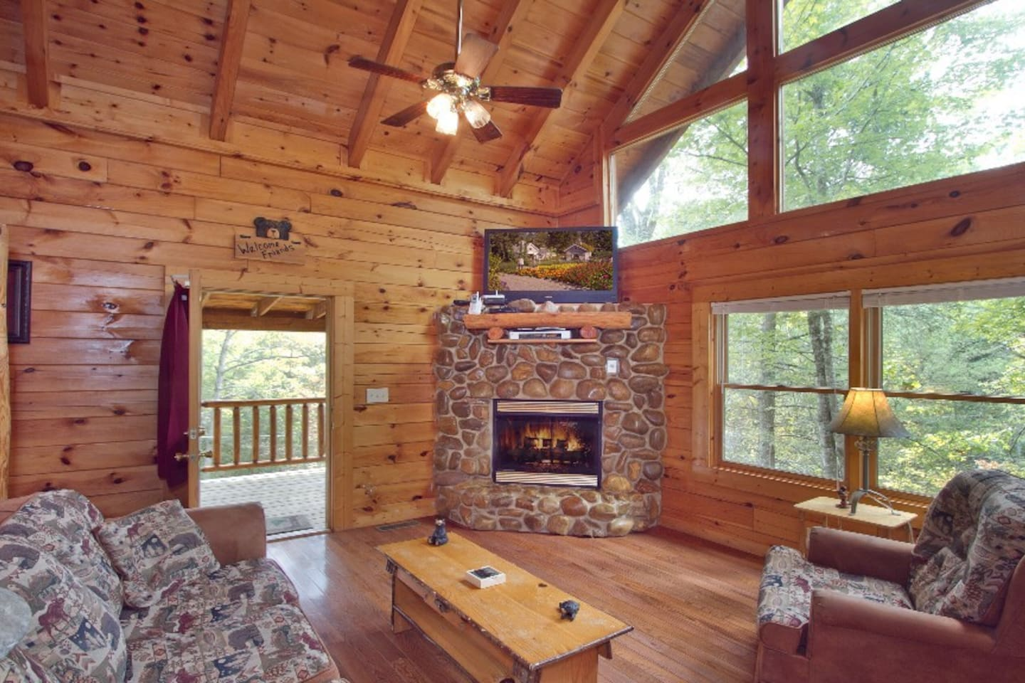 Flat screen TV w/Cable and gas stone stacked fireplace