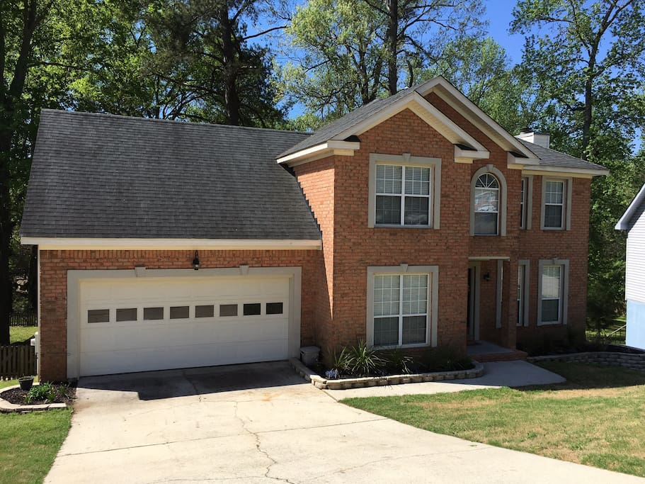 Our home is located on a small downward incline. Feel free to park on the street, in the driveway or in the garage with straight access inside the home. The garage is able to fit two average size cars.