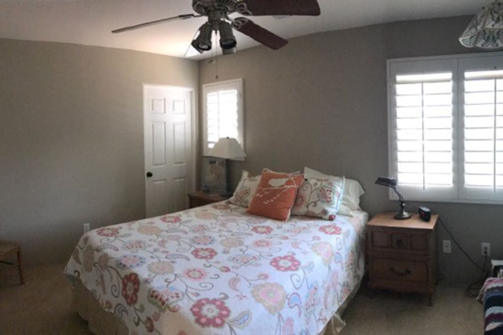 Guest bedroom with queen has restroom in hall with full bath