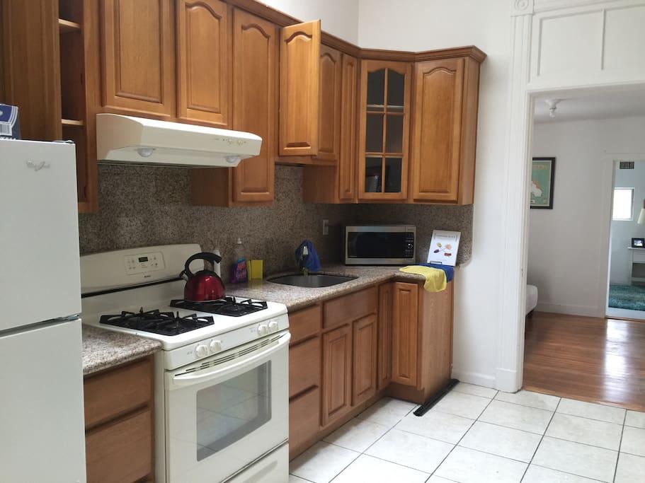 Oven range , microwave, fridge and coffee machine .