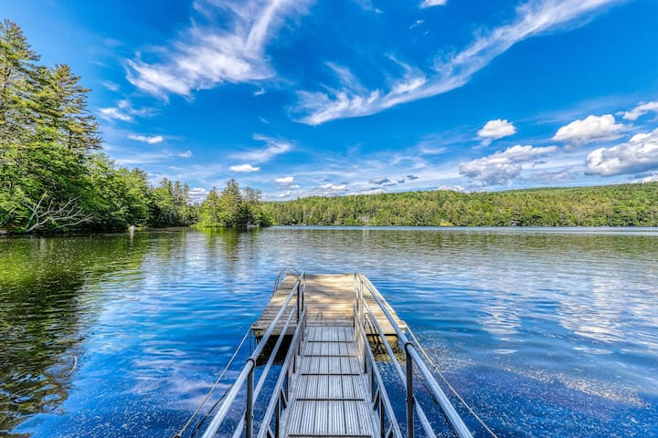 Cozy, waterfront house w/ a deck, lake views, & a private hot tub