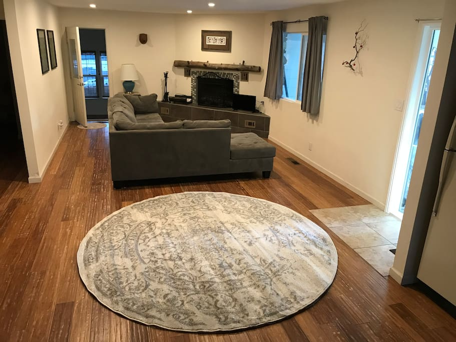 Large open living room area with fireplace