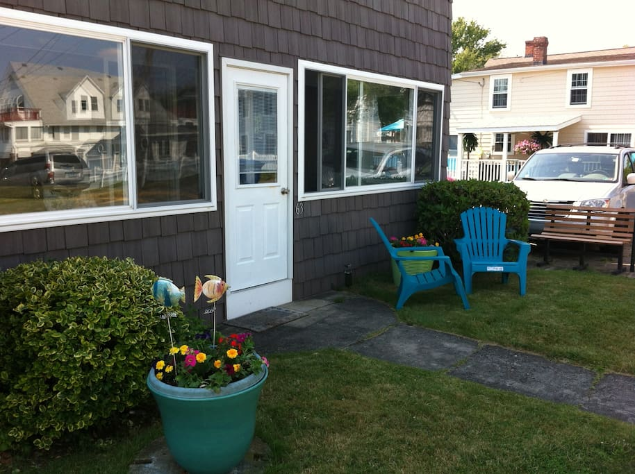 Nice area to relax in front of the cottage.   Lawn is well-maintained in season.