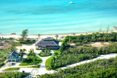 Exquisite Sunset Beachfront Estate with Mooring