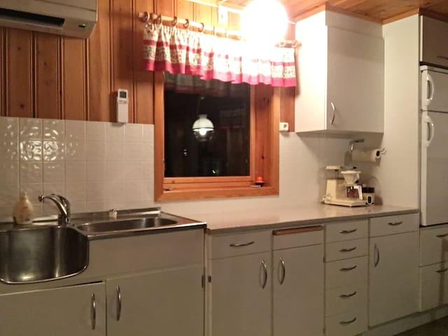 First floor kitchen: sink, fridge and basic kitchen equipment.