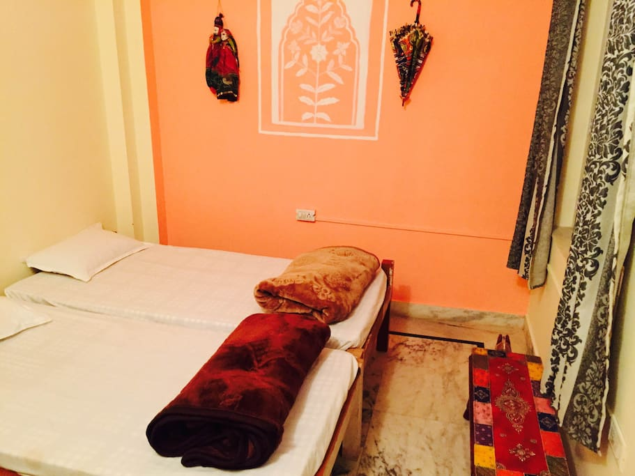 A beautifully decorated Twin private with rajasthani furniture and daily cleaning and ensuite washroom