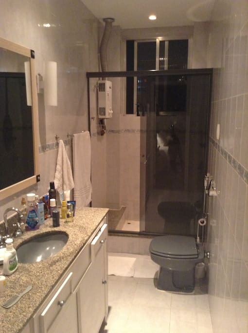 Room has own walk-in spacious bathroom with shower.