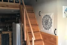 Steep stairs/almost a ladder to the loft with queen bed.