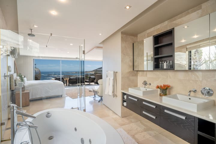 The master bedroom with an open bathroom including a freestanding bathtub and separate toilet offers luxury and privacy of the highest standard.