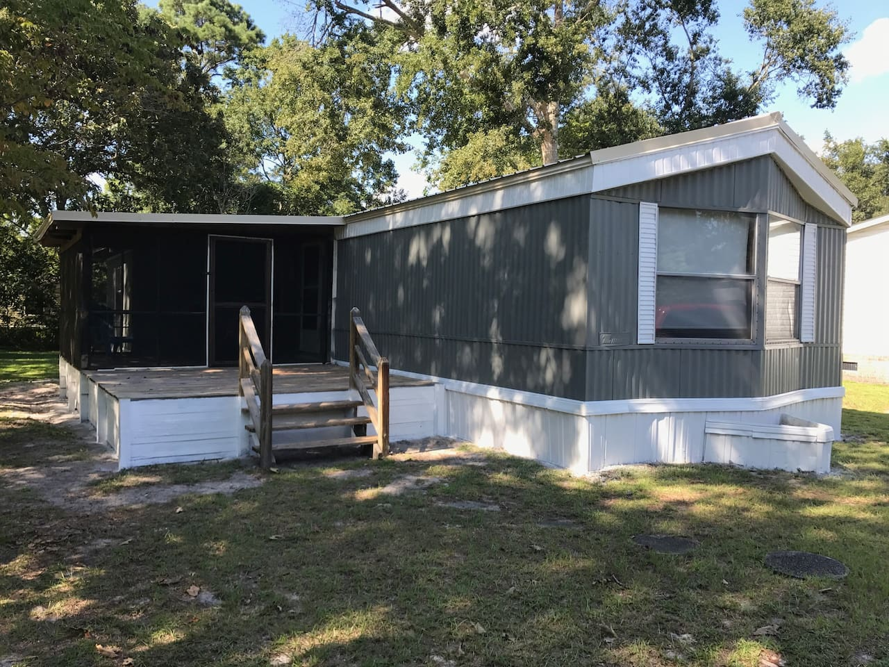 Well maintained with a new metal roof and screened in porch in quiet, vacation village.