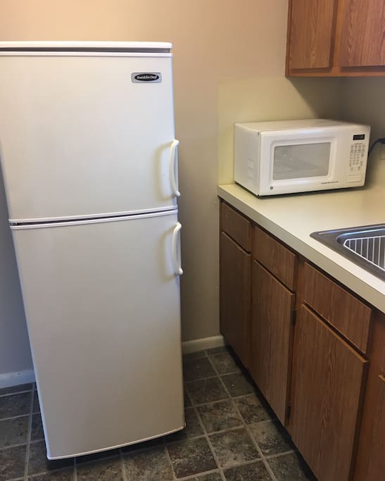 Full Kitchen with Electric Stove & Oven, Full Frig and Microwave.
