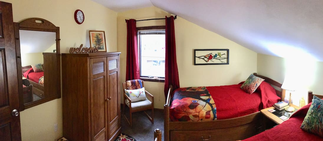 2nd bedroom with 2 twin beds. Besides the closet, there's an armoire with lots of storage in this room.